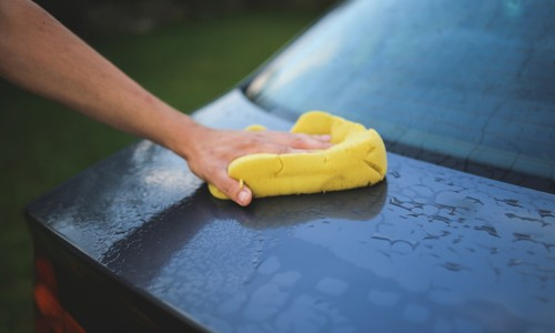 wash car with soap and water